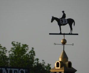 The weather vane is traditionally painted in the colors of the Preakness' winning jockey's silks.