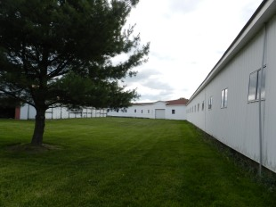Vanderbilt's original barn housed 90 horses and had an indoor training track. You can see the curve of it here.