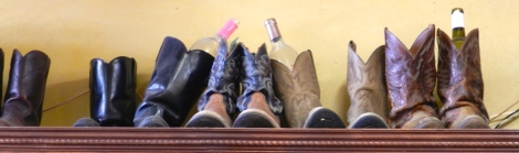 Wine club members at Fiesta Winery donate their boots which are proudly displayed on a shelf at the tasting room on Main Street in Fredericksburg, Texas.