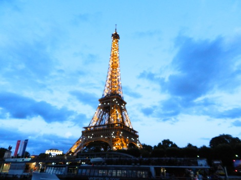 The Eiffel Tower sparkles on the hour at night.