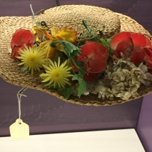 Minnie Pearl's iconic straw hat and her Mary Jane shoes are part of the fascinating display of mementoes.