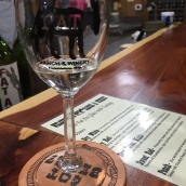 At Fat Ass' tasting room, the glass comes with a stem. The shop also stocks wine-related souvenirs and a few that revel in the winery's name.
