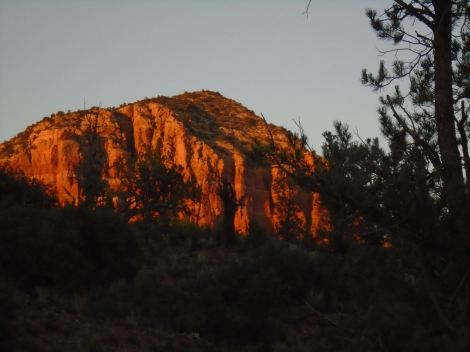 As the sun set, we had to stop and watch these red rock formations as their color deepened and glowed.
