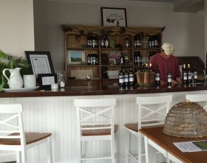 The tasting room is bright and airy with games to play or a water view to admire for those who stop by for a glass or a full tasting.