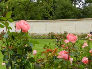 A long wall behind the cemetery recalls those missing after D-Day.