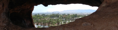 Look through the rock to see Phoenix, or at least the Phoenix Zoo and a bit of the city and mountains beyond.