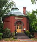 The octagonal Old Library, now owned by the New Castle Historical Society, was opened in 1892 and is now used as a meeting space and museum.