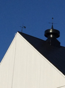 Weathervanes atop the Prys' barn.