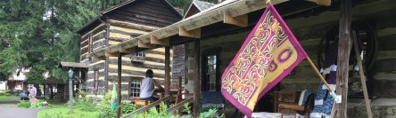 Weaver Ann works her magic on the porch of the Glotfelty House at Spruce Forest Artisan Village in Grantsville, Maryland.