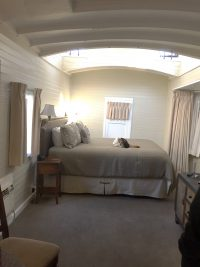 Room enough in the caboose rooms at the Napa Valley Railway Inn for a bed, a table for two and a small bath.