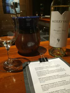 Merryvale's tasting room is surrounded by wine barrels fragrant with wine.
