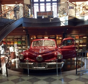 The car from Tucker dominates the two-level Movie Gallery.