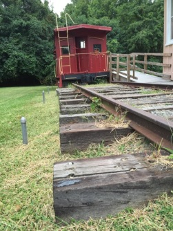 Stop by the train station and take a look in the caboose parked outside.